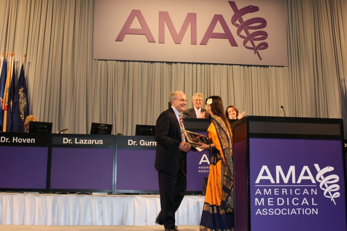 Dr. Stead Receiving AMA Award